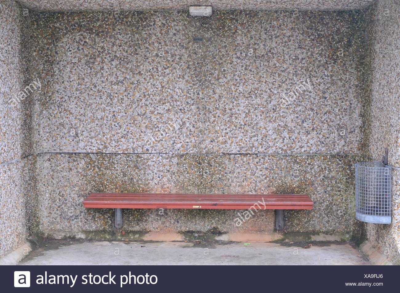 Bus stop from seventies, with bench and garbage can - Stock Image