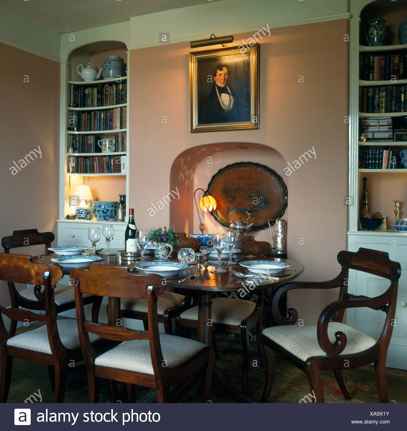 Alcove Bookshelves In Traditional Dining Room With Antique Furniture And  Picture Above Fireplace Alcove