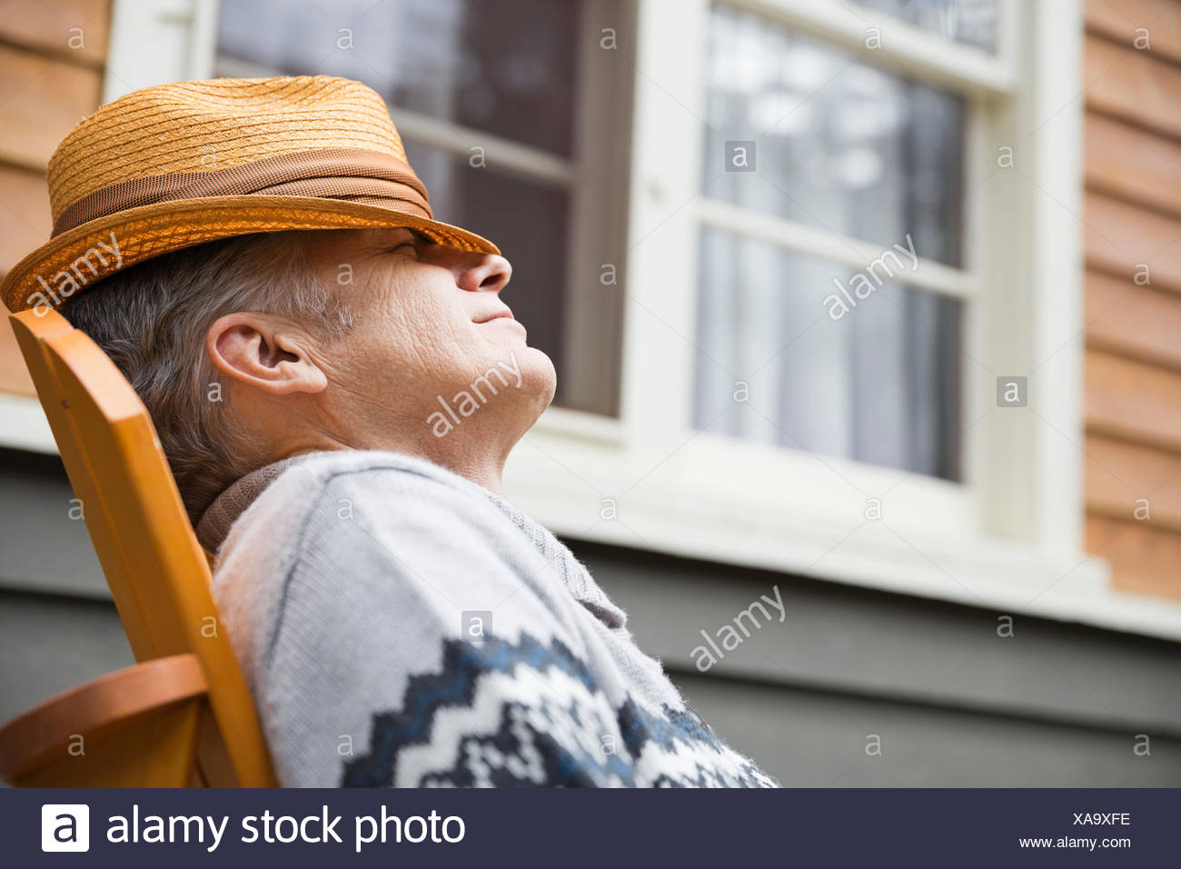 Middle-aged man relaxing outside - Stock Image