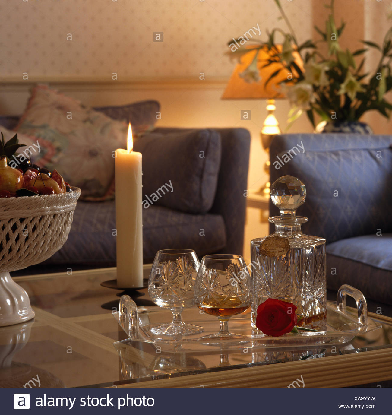 Decanter And Glasses On Table With A Lighted Candle In Eighties Living Room