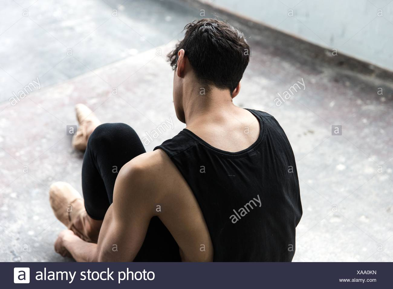 Dancer wearing ballet shoe in studio - Stock Image