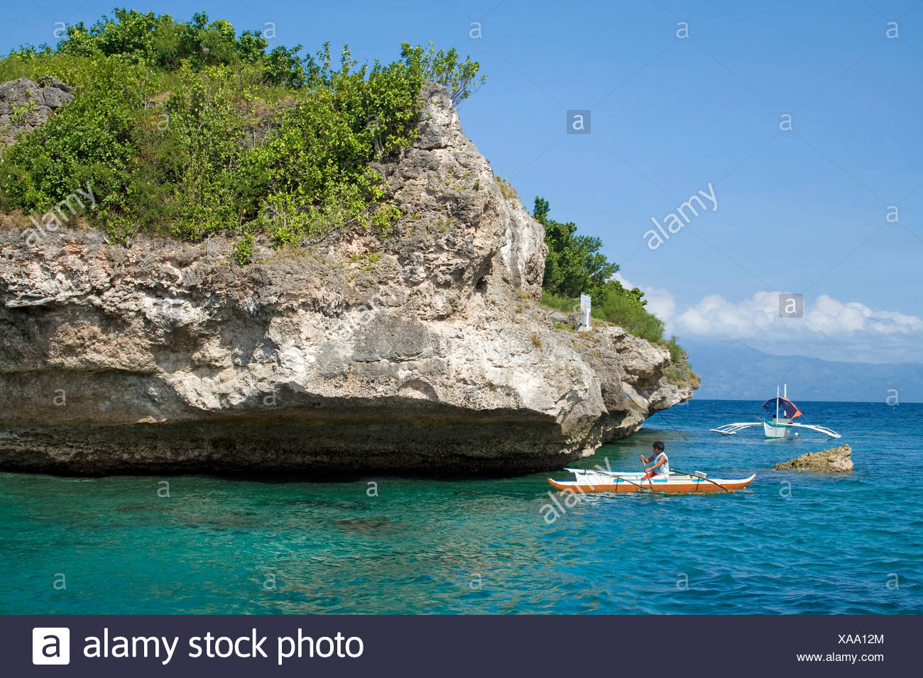 Fishing boat off Pescador Island, well-known dive site and marine park, Moalboal, Cebu, Philippines, Indo-Pacific region, Asia - Stock Image