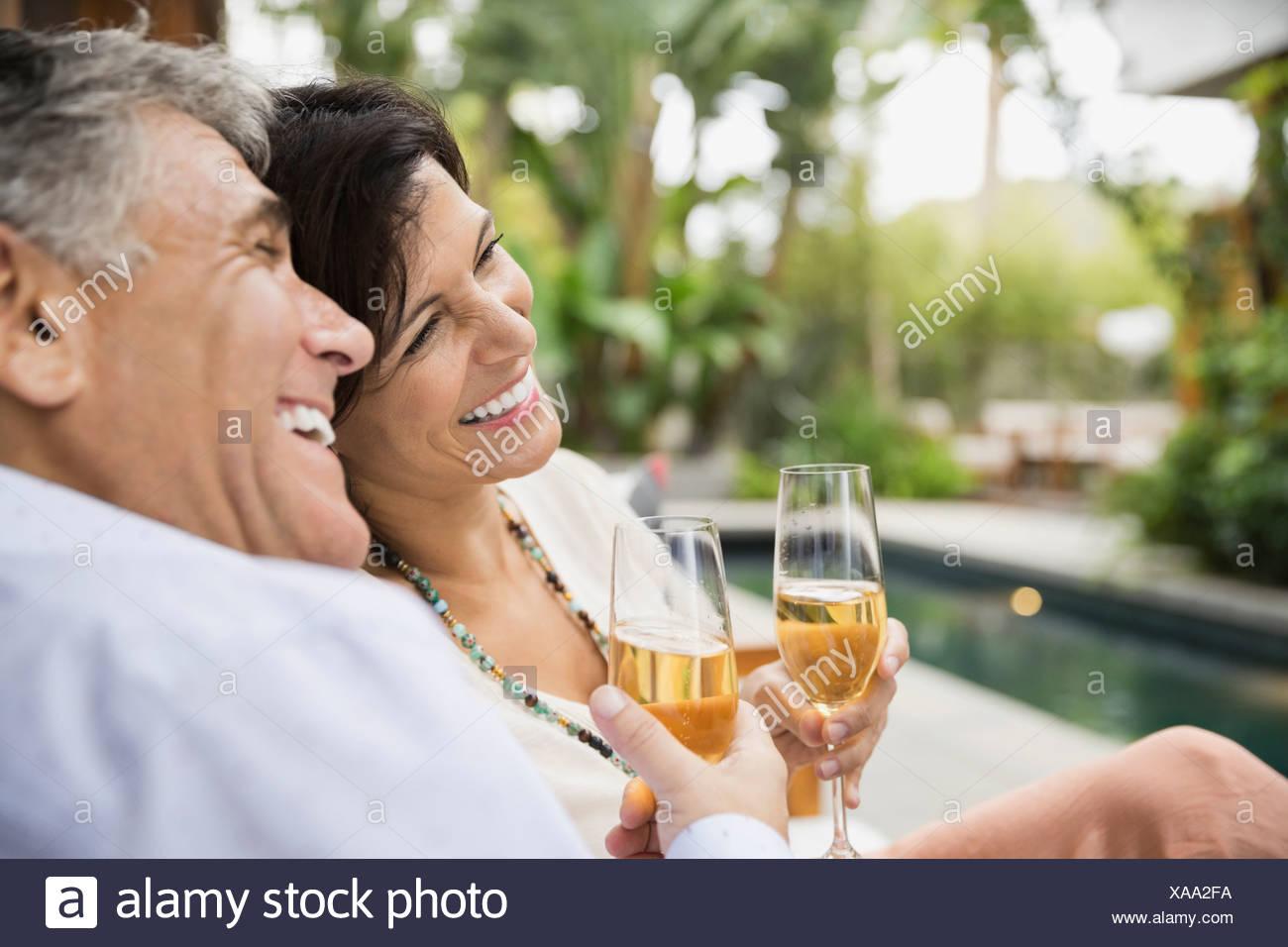 Mature couple enjoying champagne - Stock Image