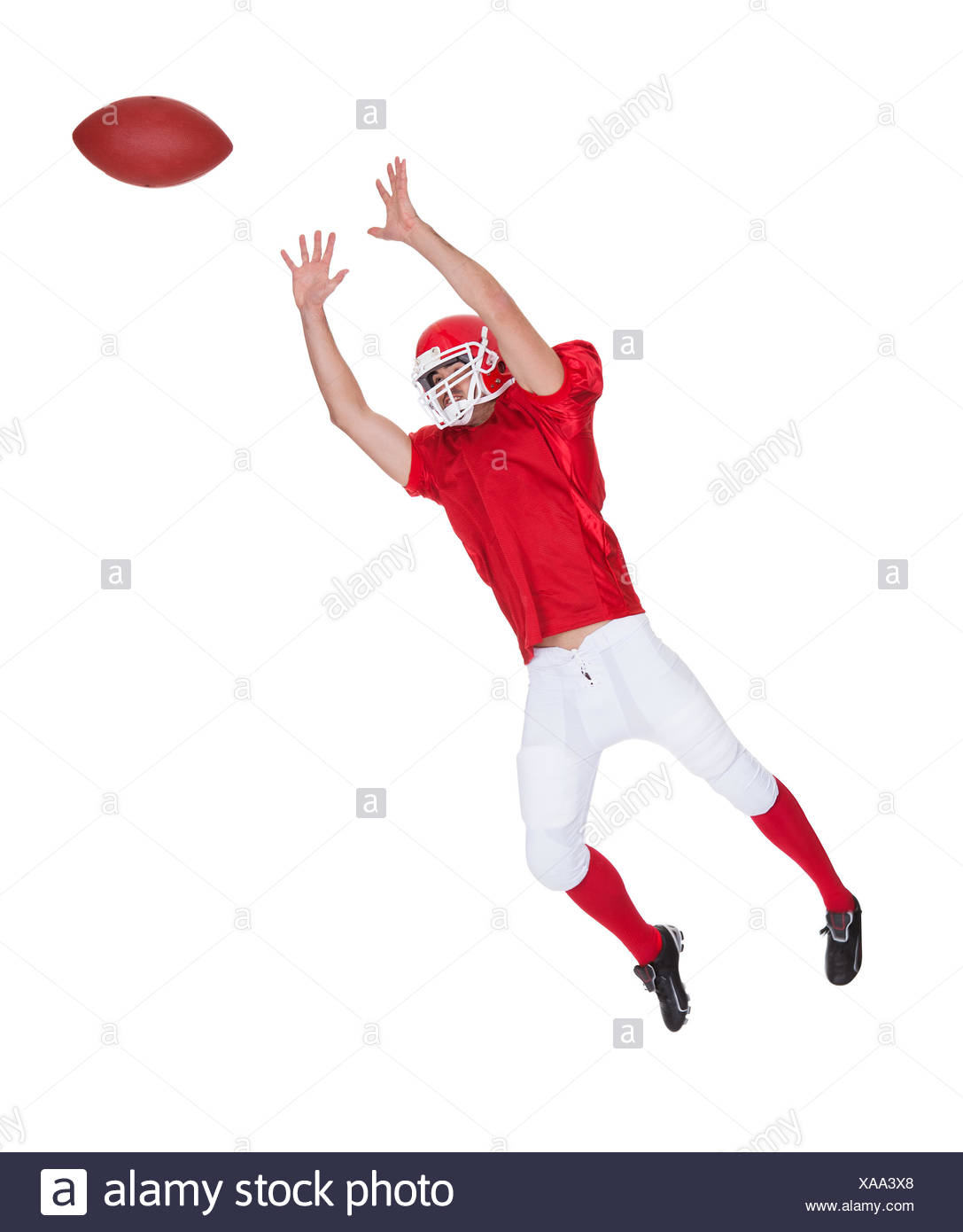 American Football Player Catching Ball Isolated On White