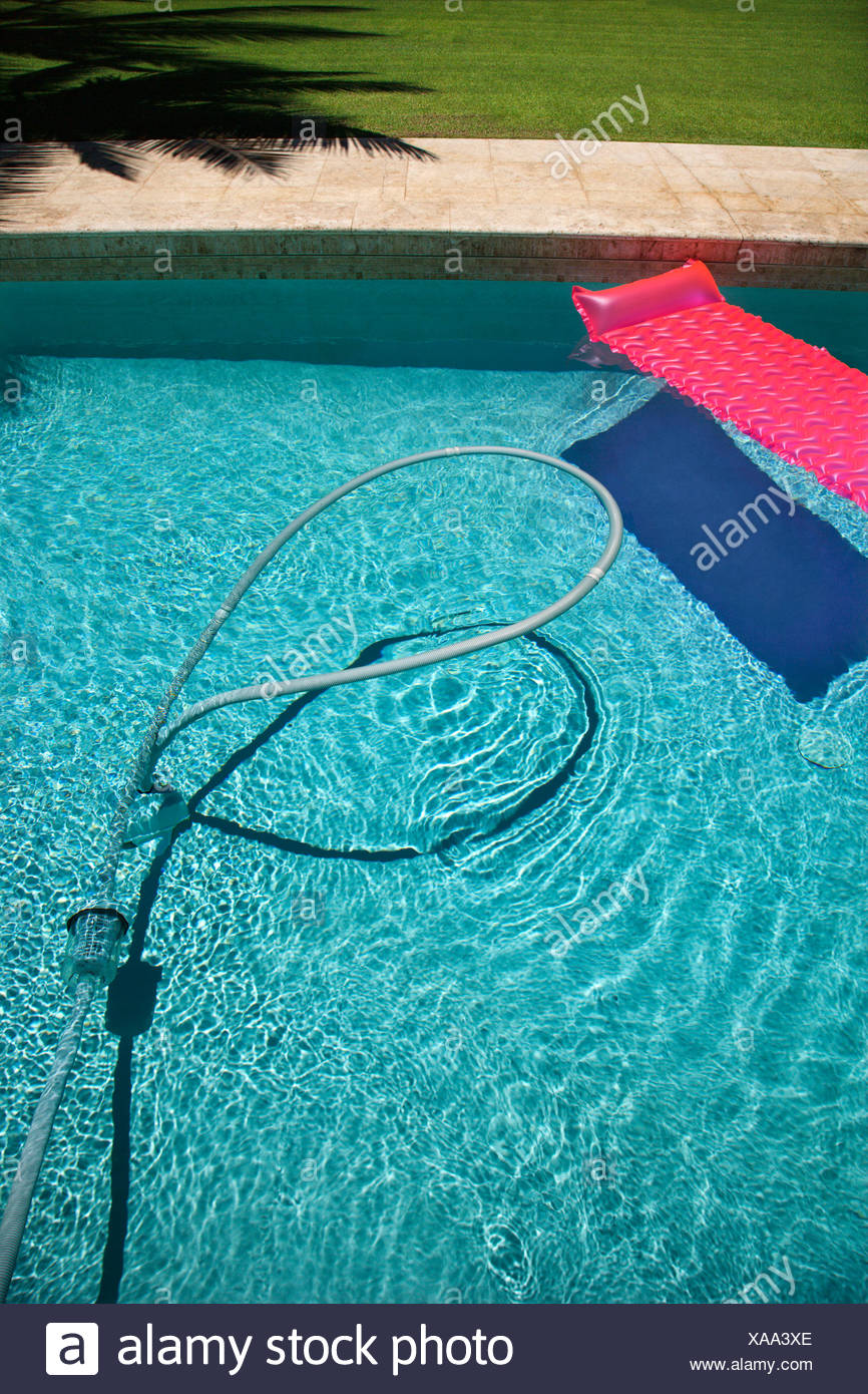 Pink float and vacuum hose in swimming pool Stock Photo ...