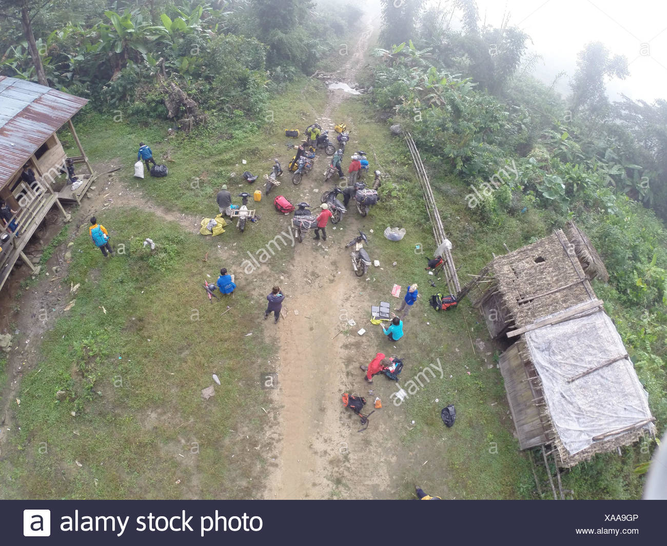 A high angle view of the expedition party organizing gear and equipment. - Stock Image