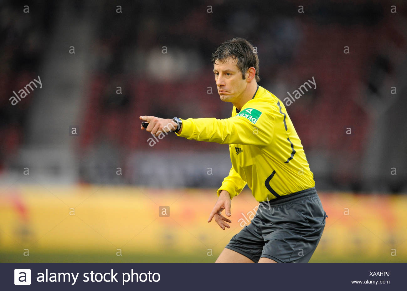 Wolfgang Stark, German football referee, indicating to play on - Stock Image