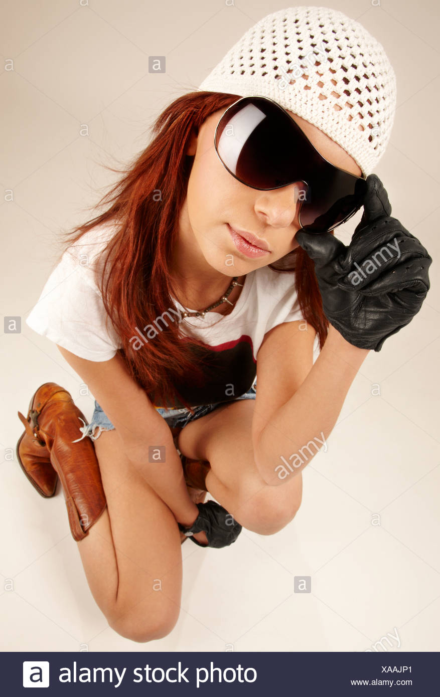 wideangle portrait of cool girl in big sunglasses - Stock Image