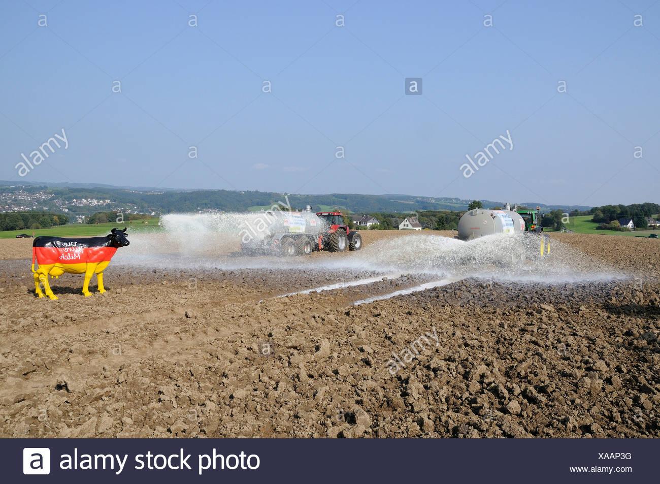 Dairy farmers dumping their milk in protest on a field, Overath, Rheinisch-Bergische Kreis, North Rhine-Westphalia, Germany, Eu - Stock Image