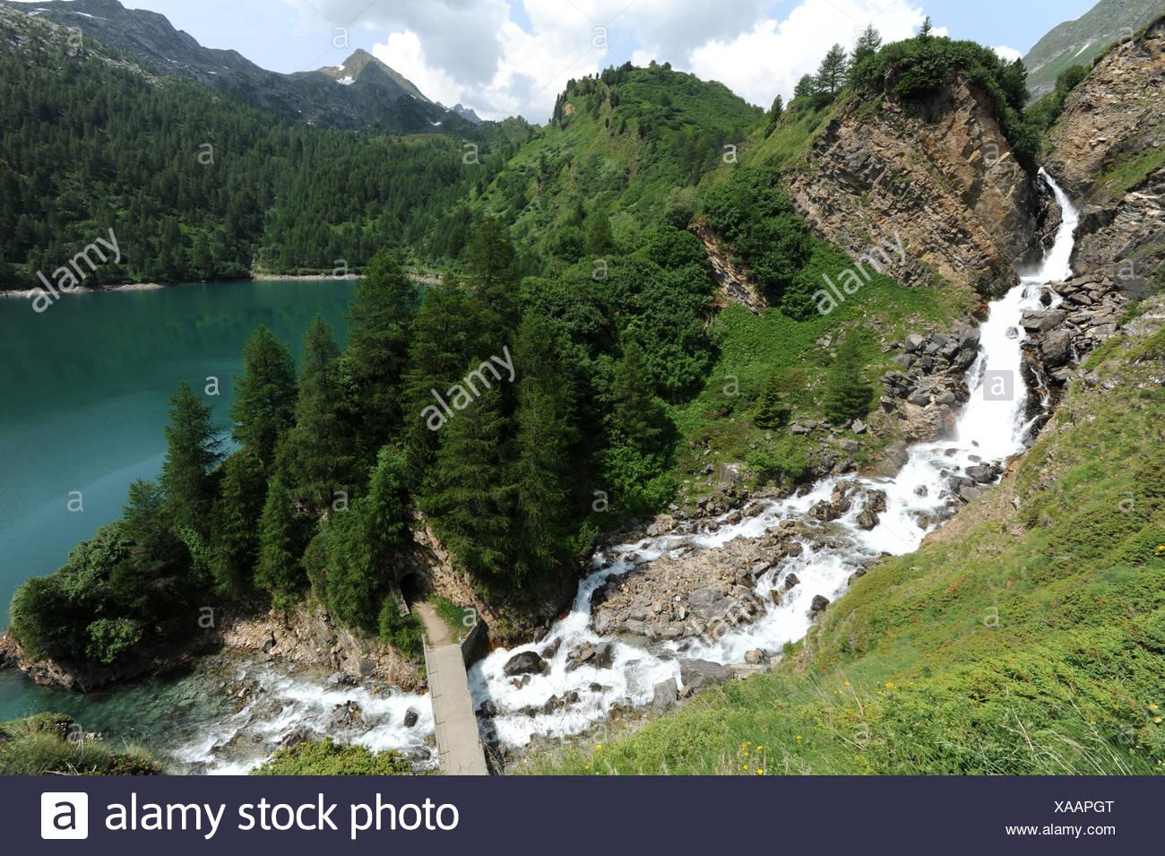 Switzerland, Ticino, Ritom, Piora, waterfall, rock, cliff, lake, scenery Stock Photo