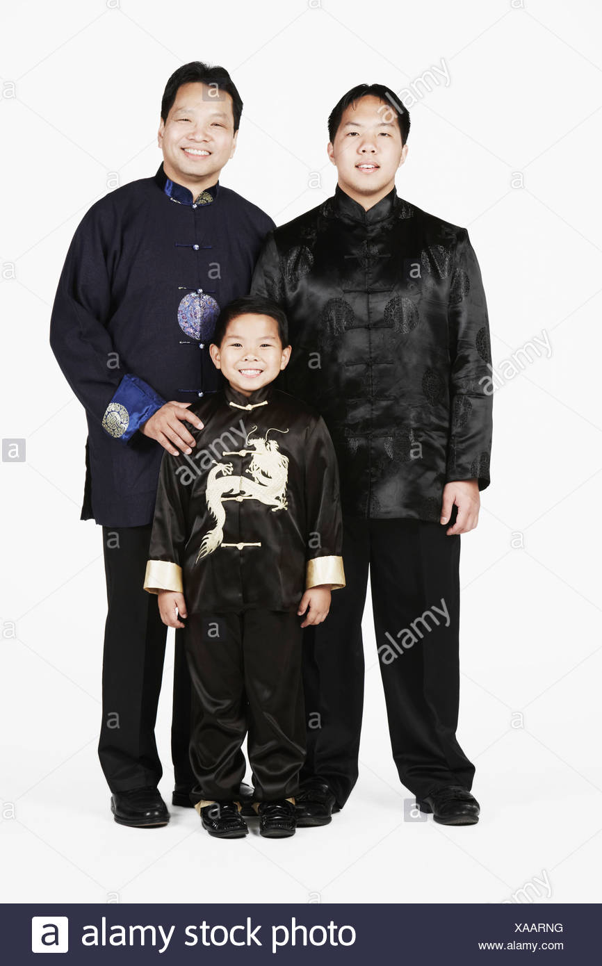 Portrait of a father standing with his two sons - Stock Image