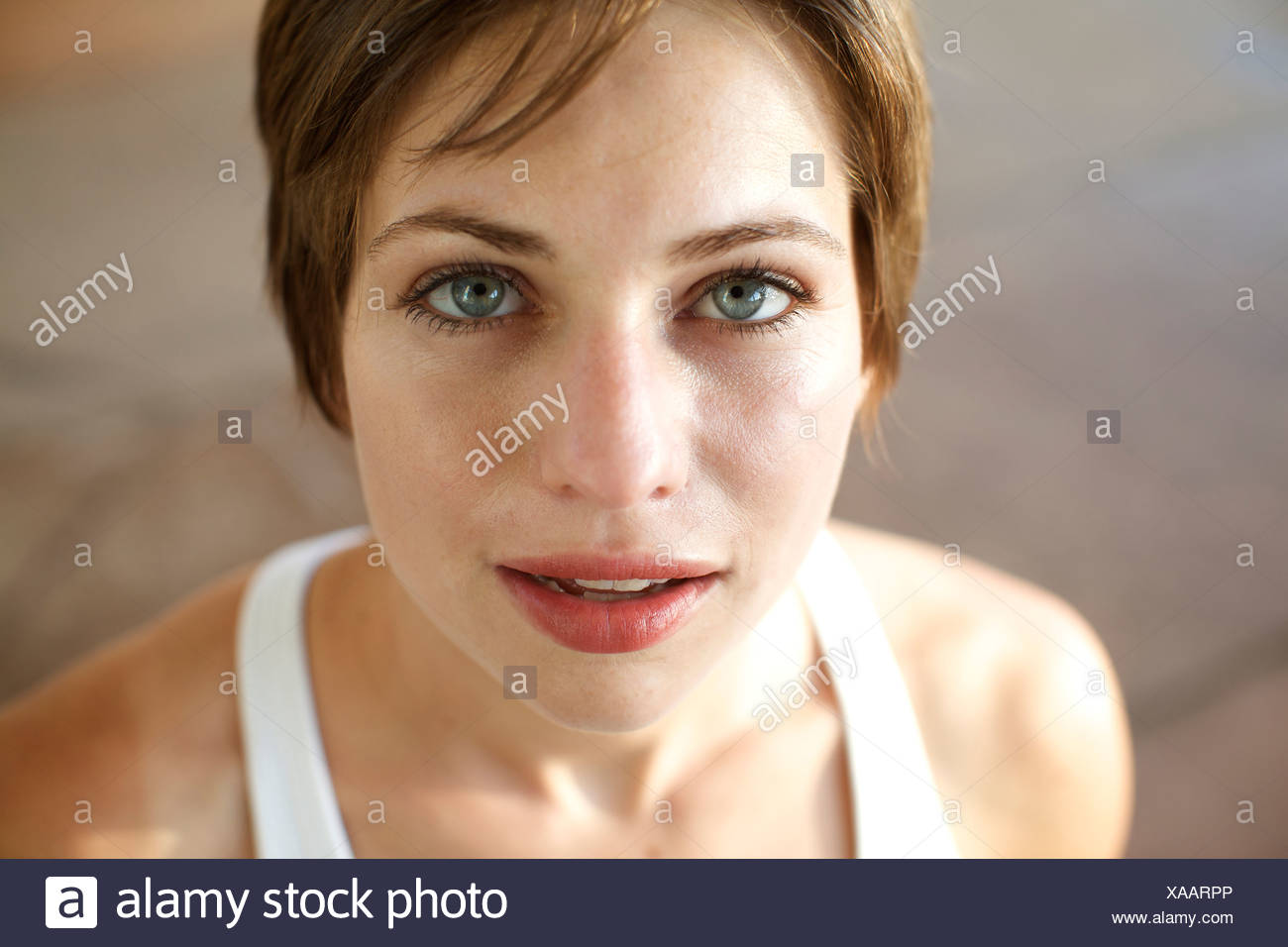 Portrait of a woman with short hair looks up at the camera with in San Diego, California. - Stock Image