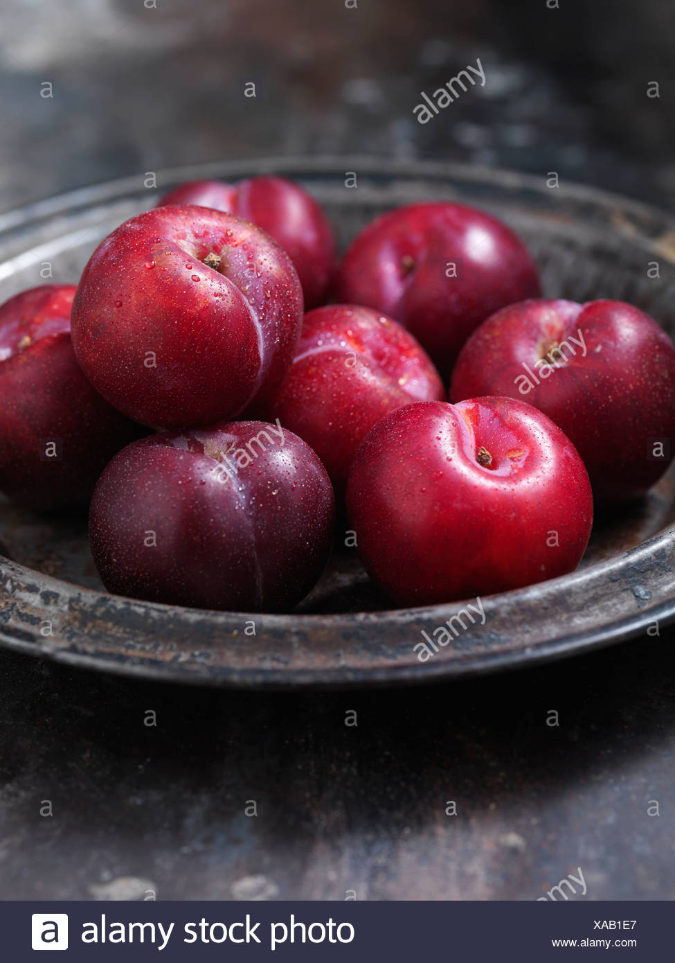 Close up of bowl of plums - Stock Image