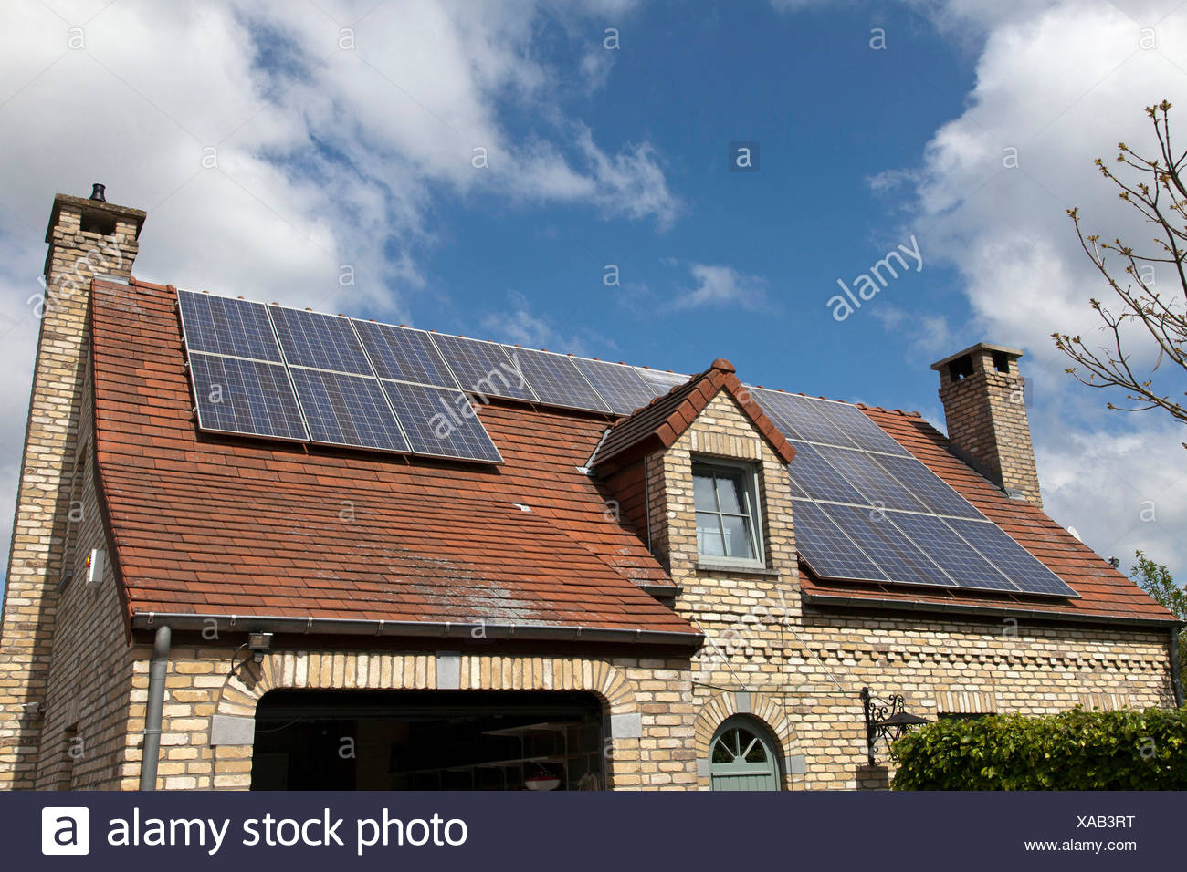 Detached house with solar panels on roof Stock Photo