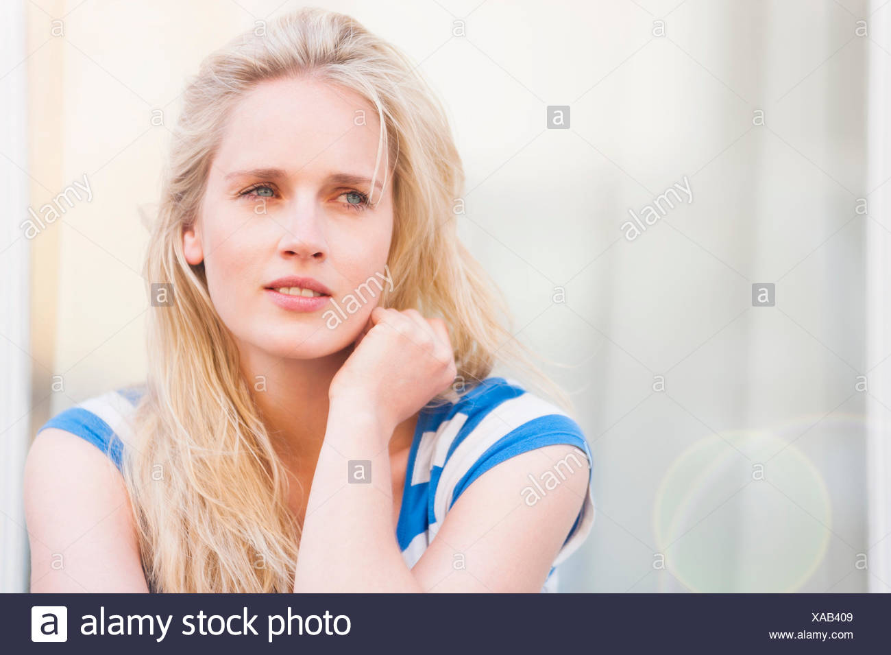 Portrait of young woman with pensive expression - Stock Image