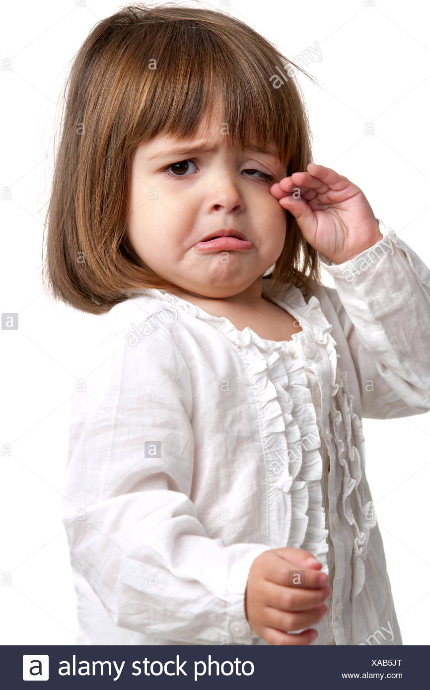 Unhappy little girl crying - Stock Image
