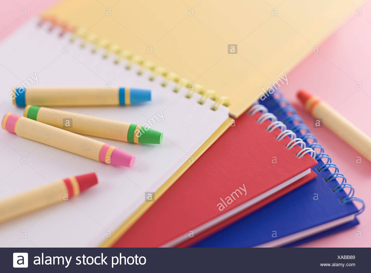 Notebook and crayon - Stock Image