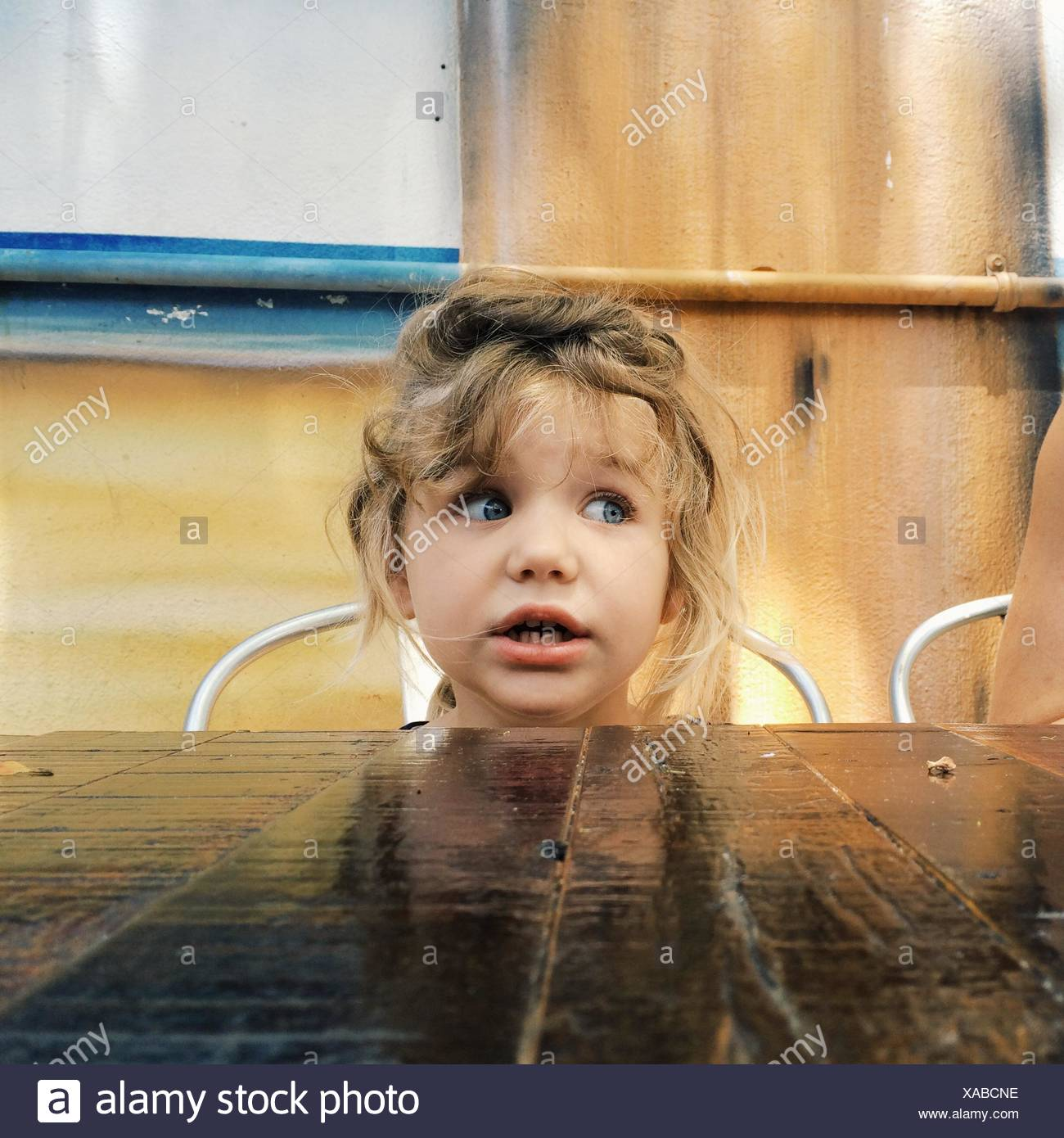USA, Florida, Palm Beach County, West Palm Beach, Girl (2-3) sitting at table - Stock Image