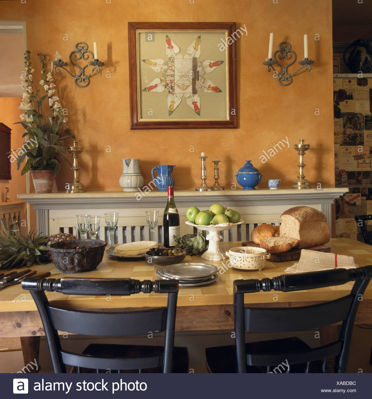 Interiors traditional dining rooms pictures stock photos interiors large picture above fireplace in traditional ochre colored dining room with table set for lunch dzzzfo