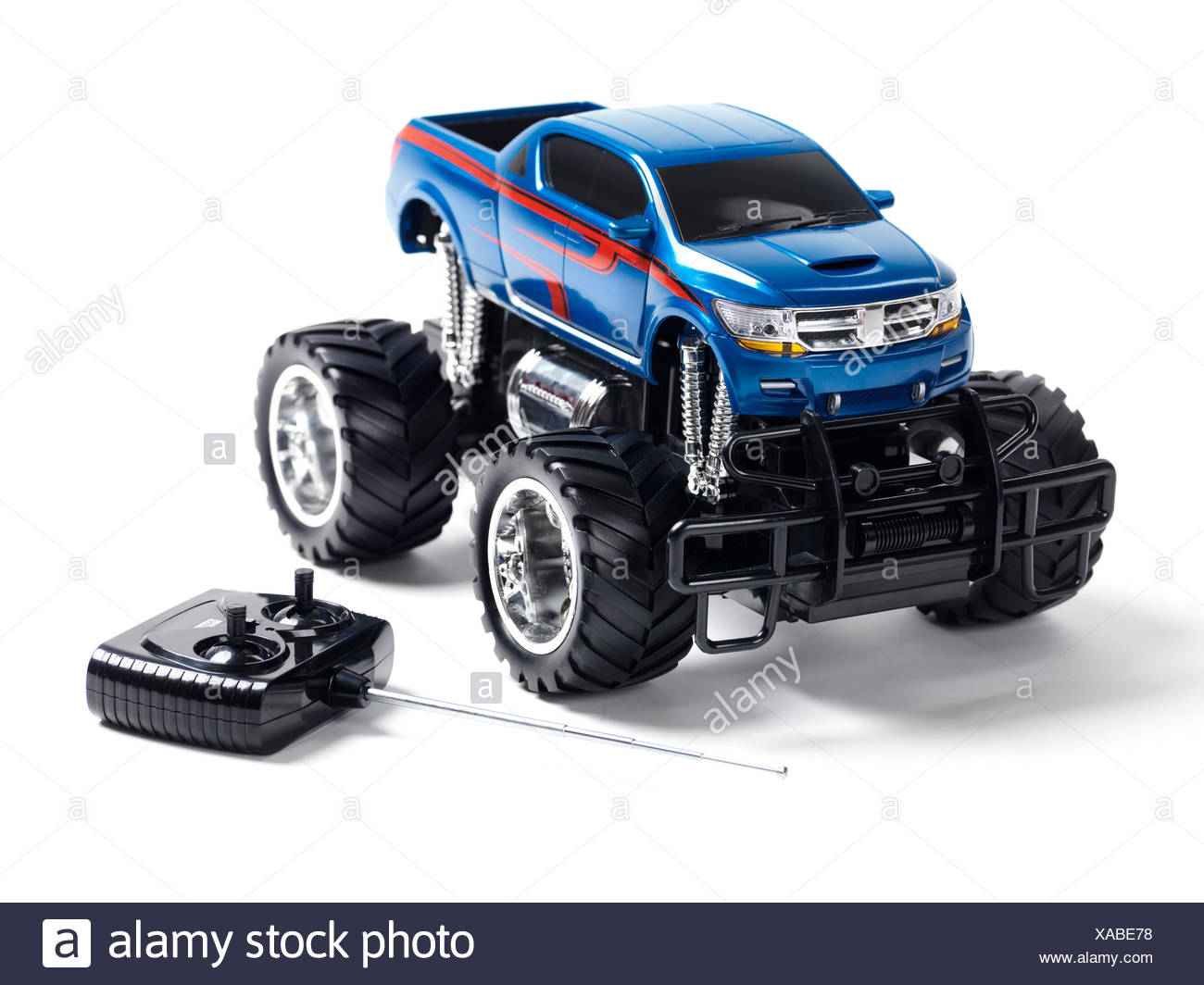 Radio controlled toy monster truck with a remote control - Stock Image