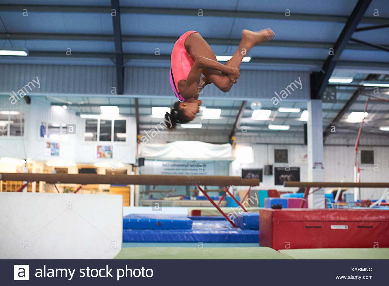 Young gymnast practising moves - Stock Image