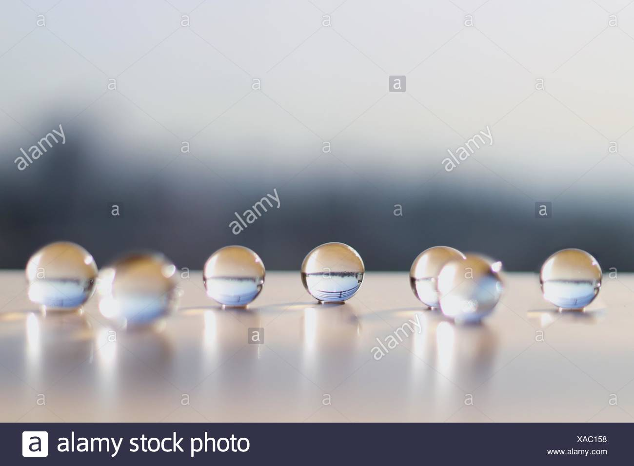 Close-Up Of Glass Marbles On Table - Stock Image
