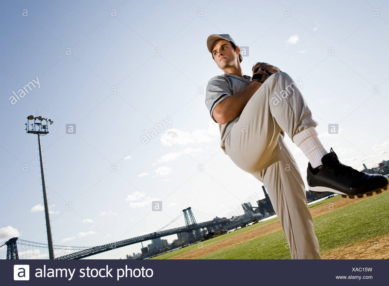 Baseball pitcher standing on one leg - Stock Image