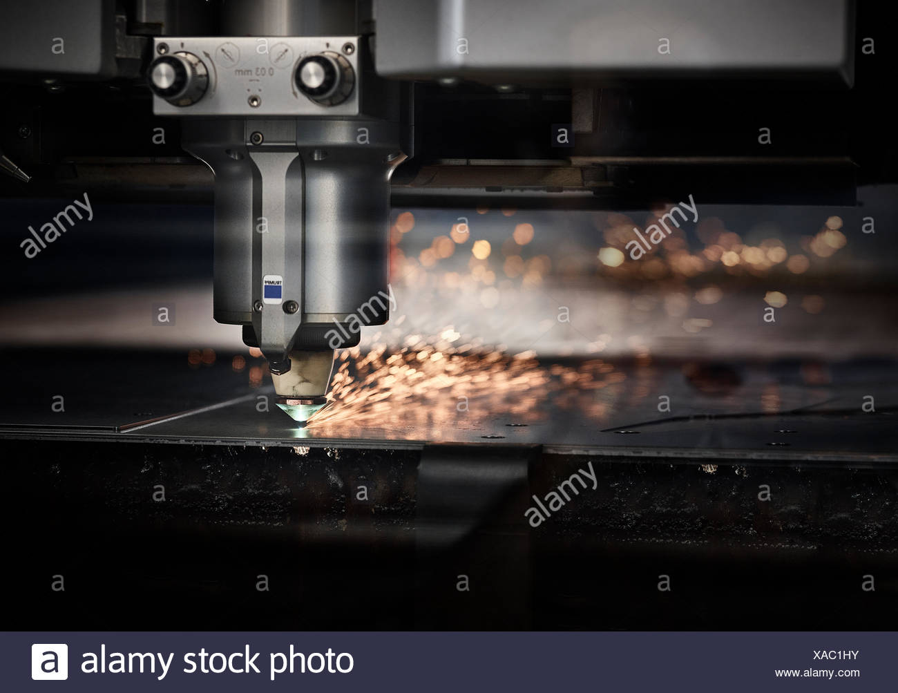Laser cutter machine with sparks - Stock Image