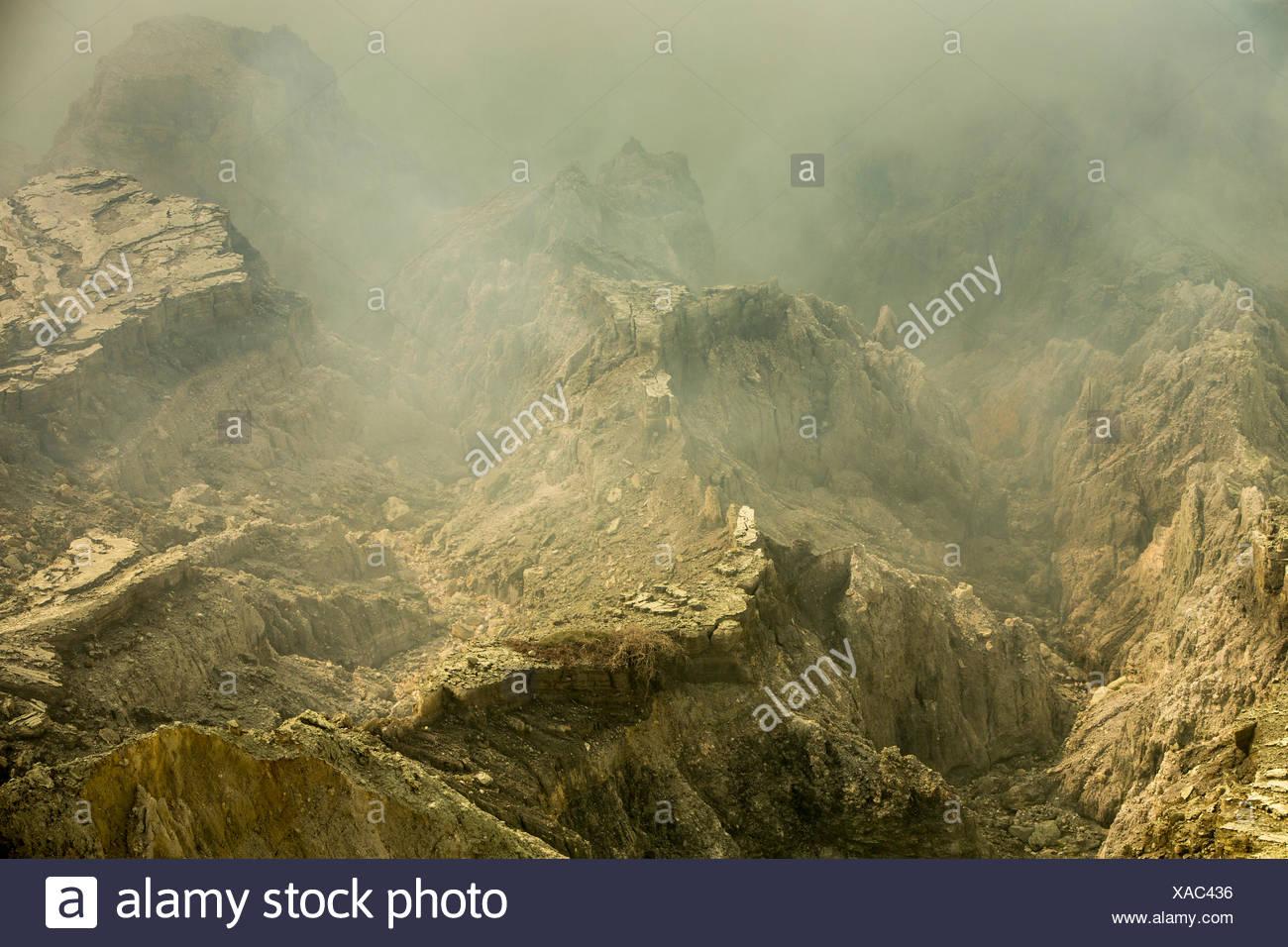 Eroded volcanic landforms of Kawah Ijen volcano, Banyuwangi, Java, Indonesia - Stock Image