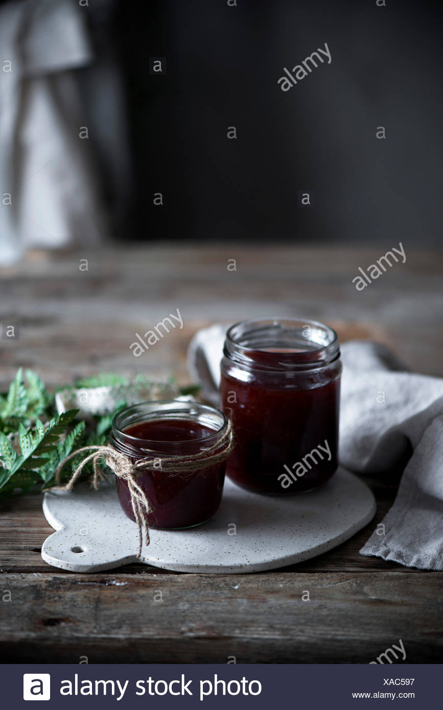 Home made jam in a country kitchen - Stock Image