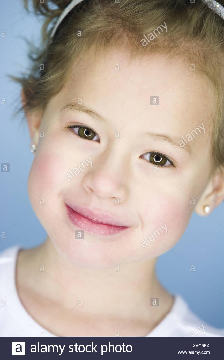 Little girl posing and yawning - Stock Image