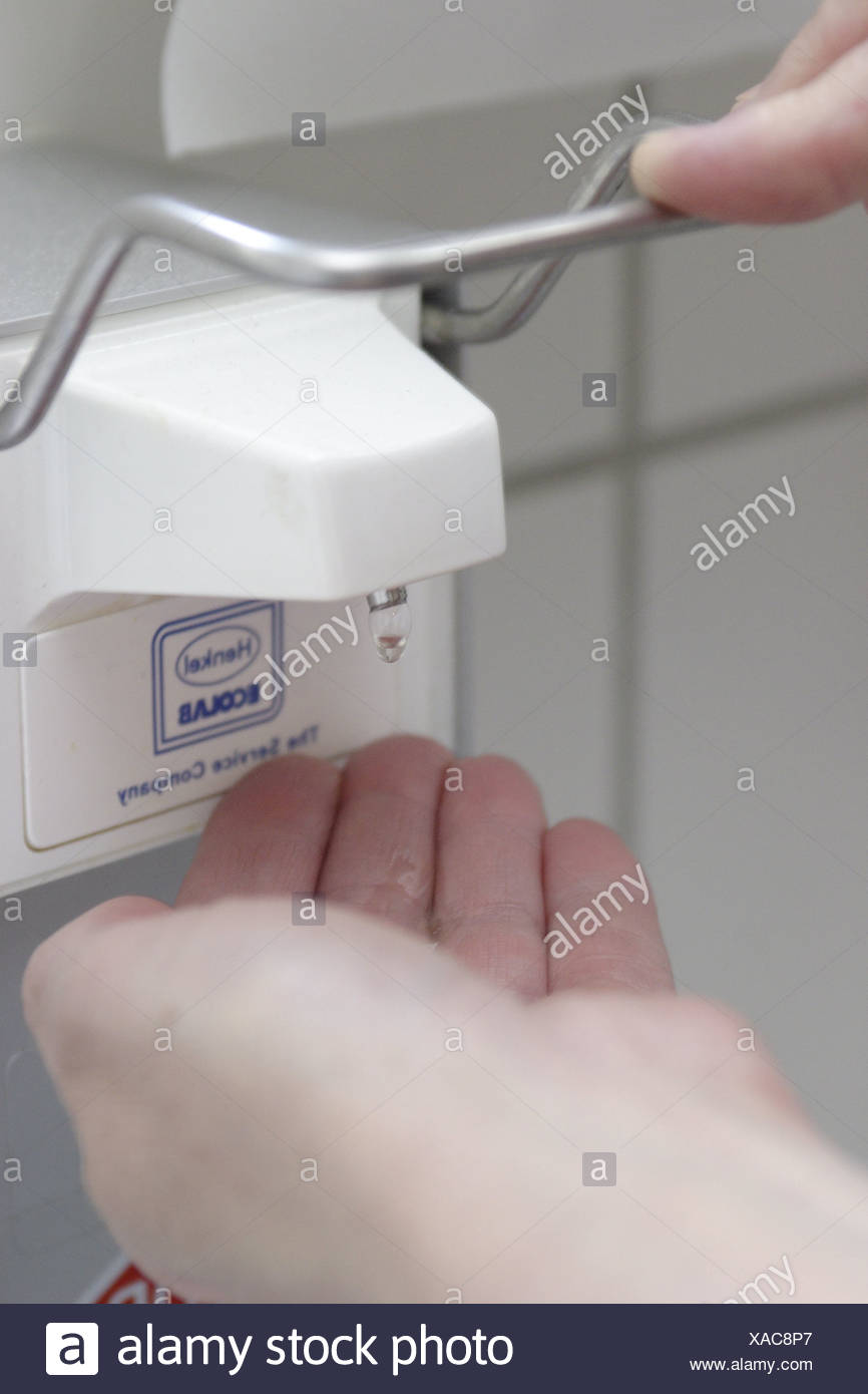 Hand-wash-basins operate bath wash-basins hands soap-donors wet-cell armatures faucet towel-donors paper-towels donors - Stock Image