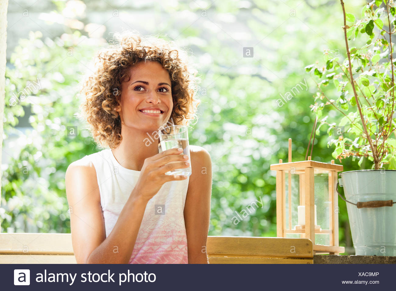 Smiling woman drinking glass of water Stock Photo