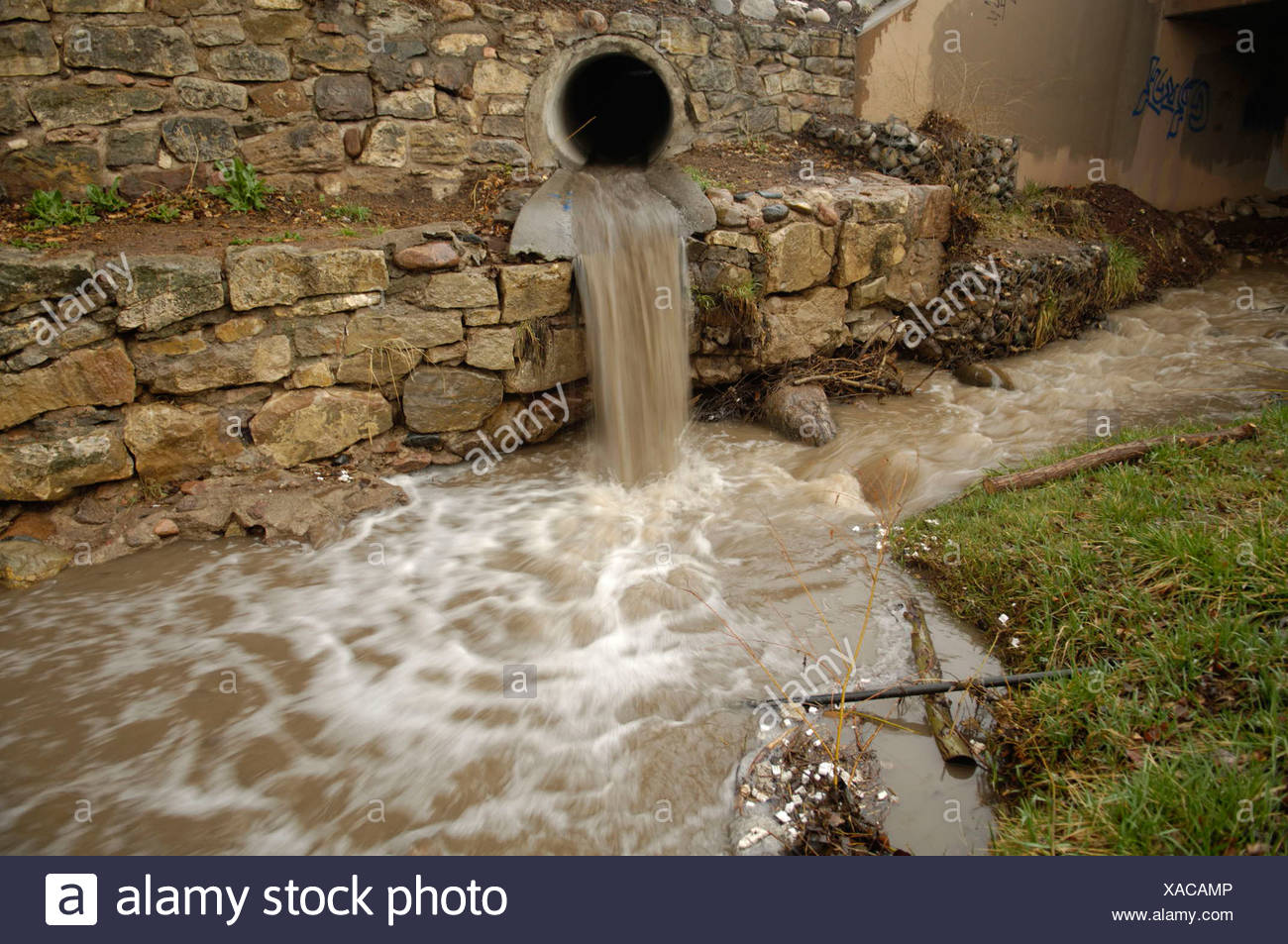 Storm sewer water rushes into a stream near the Santa Fe's downtown. - Stock Image