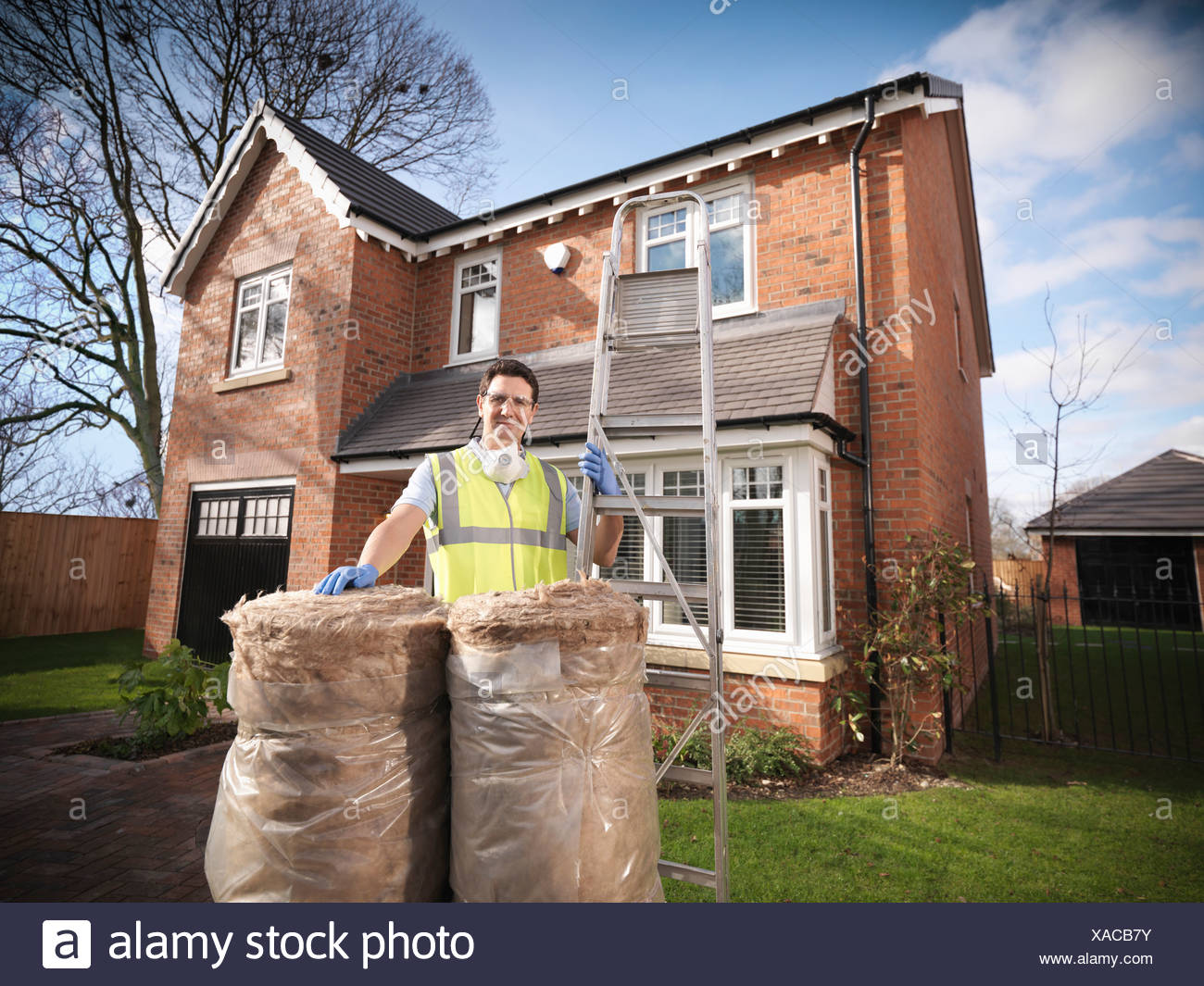 Contractor with rolls of insulation Stock Photo