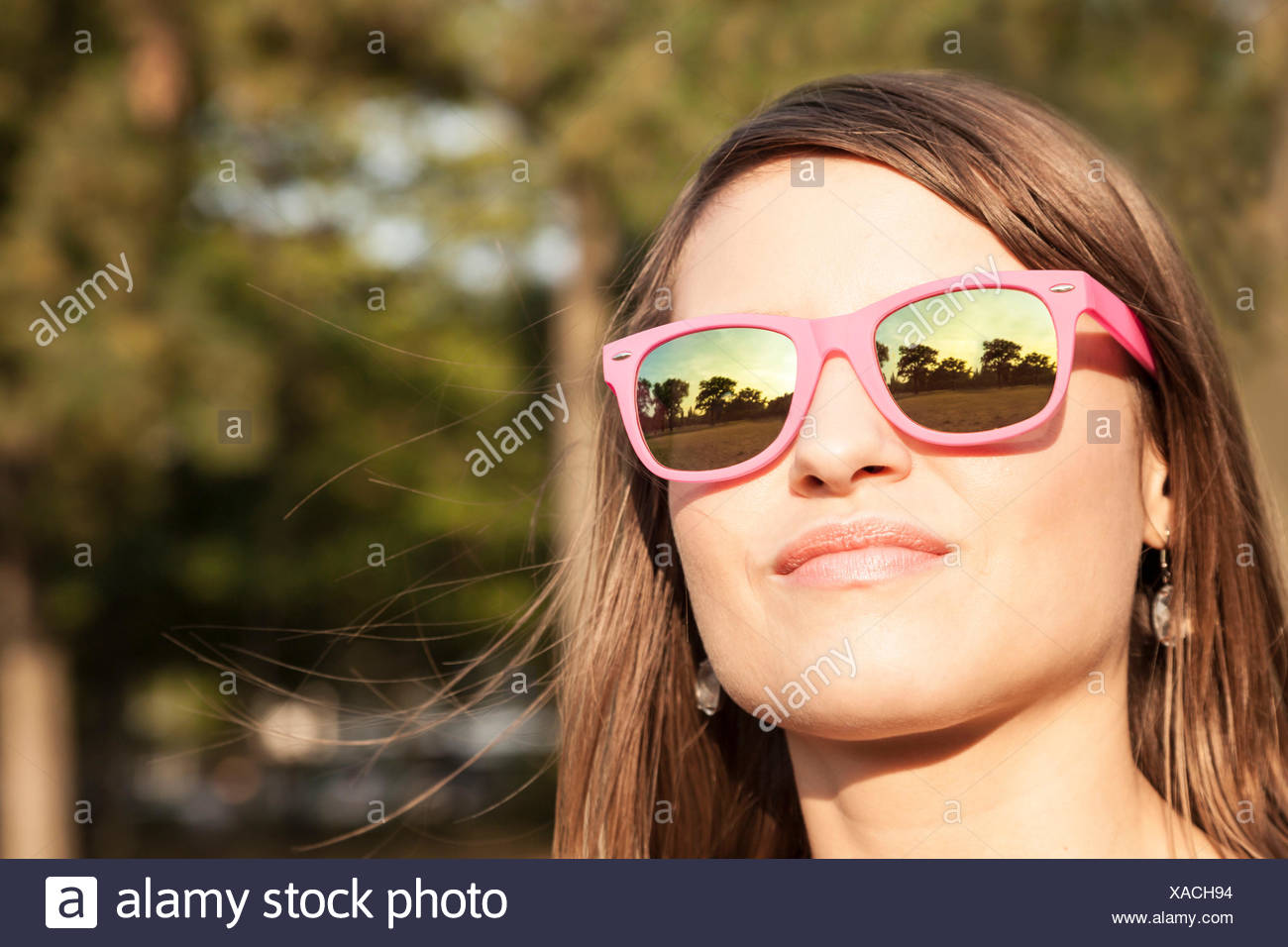 Young woman with pink sunglasses - Stock Image