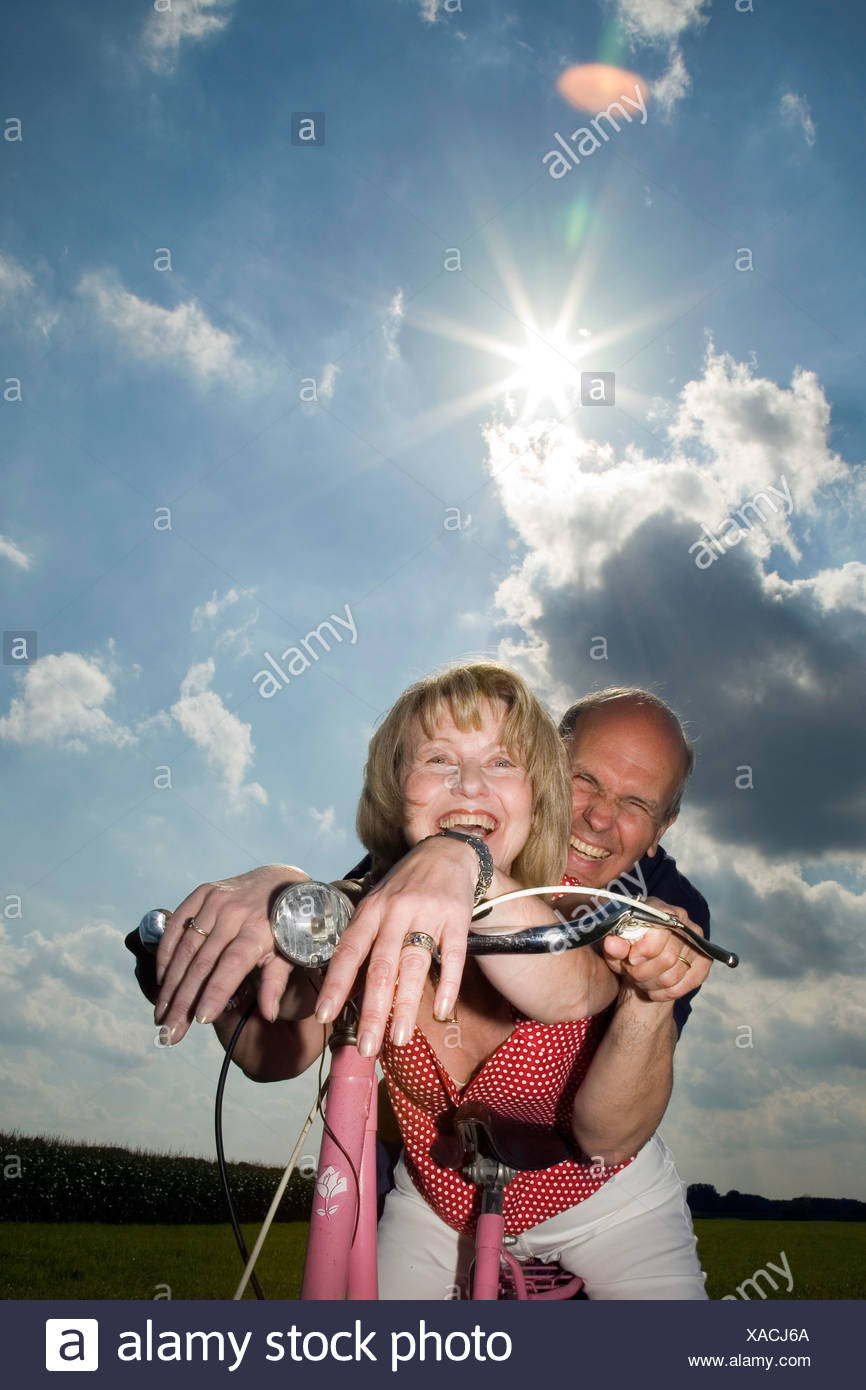 mature couple riding bike stock photo: 281790162 - alamy