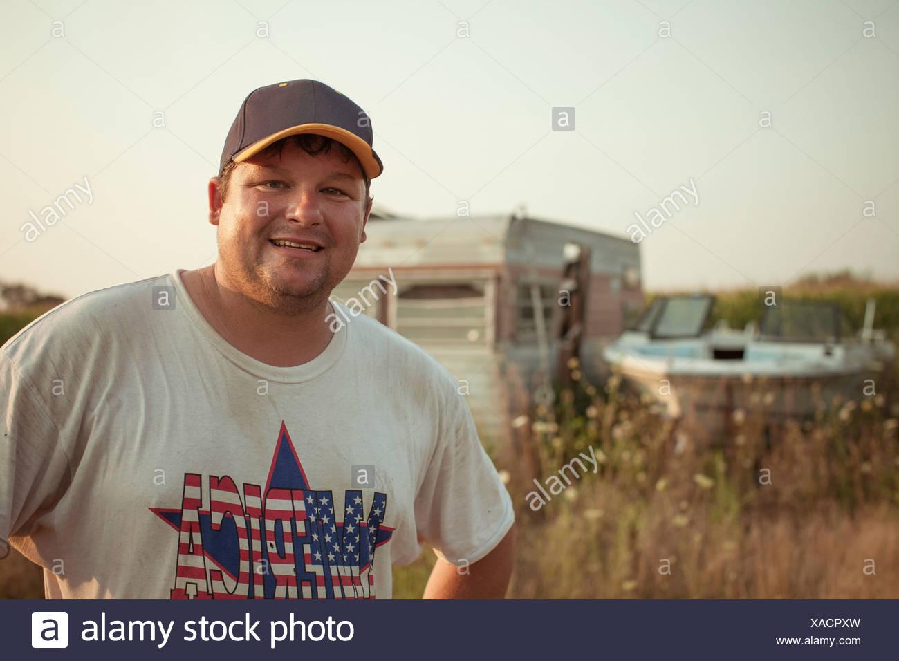 Portrait of man wearing patriotic t shirt - Stock Image