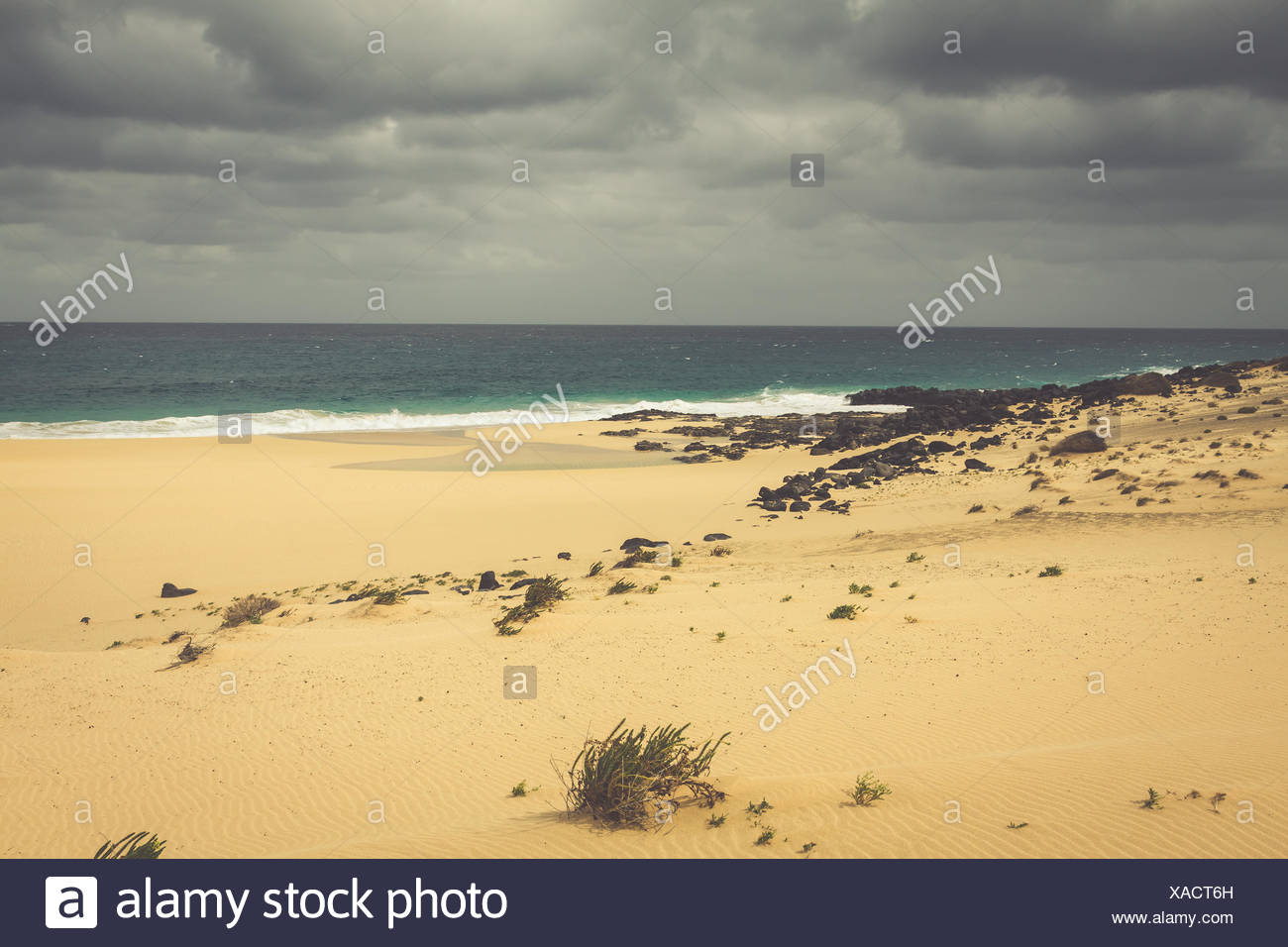 A view of Playa de Las Conchas, a beautiful beach on La Graciosa, a small island near Lanzarote, Canary Islands, in the middle of the Atlantic Ocean. - Stock Image