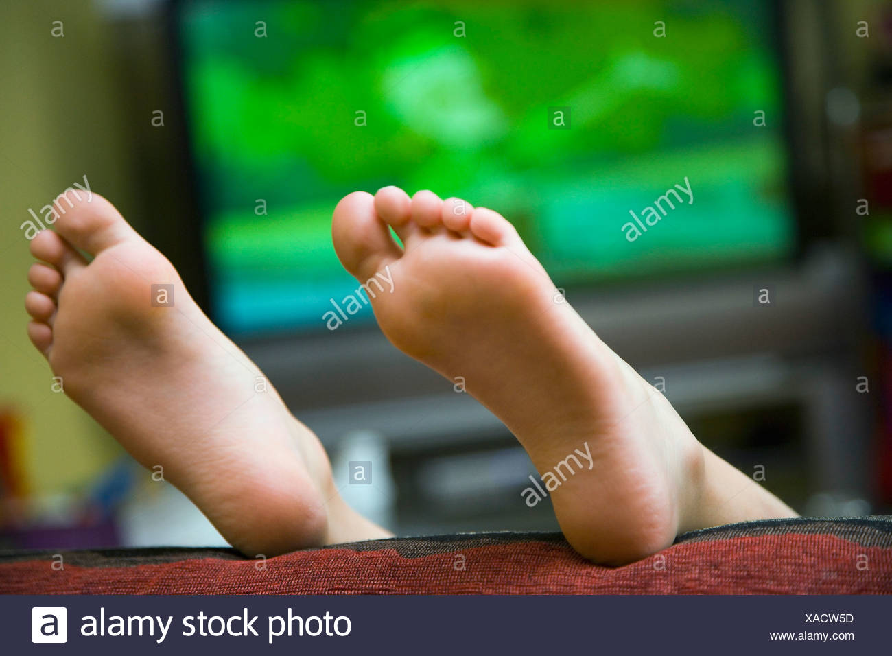 finest selection 68ee6 d6c85 Child lying on sofa with feet in air