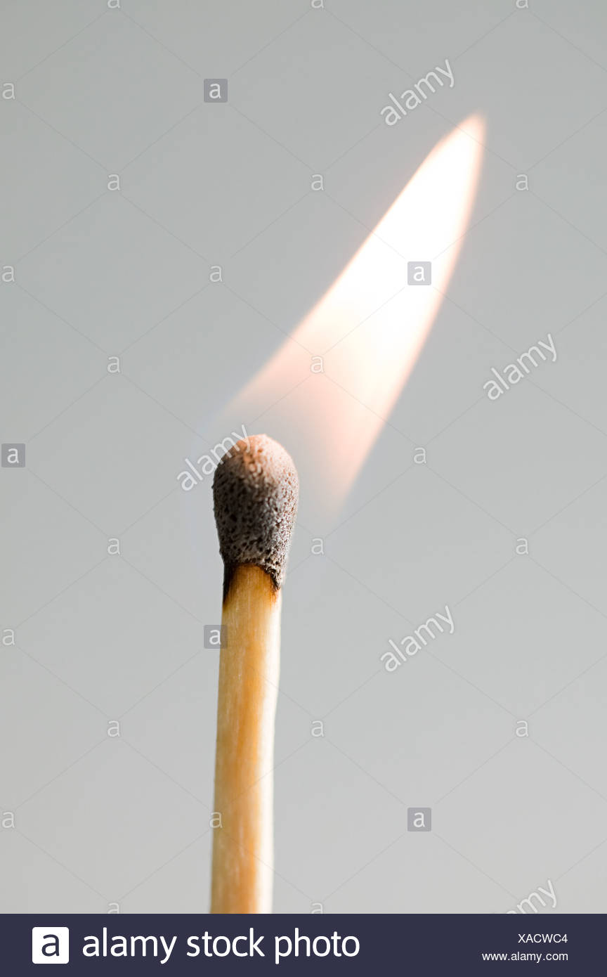 A burning match - Stock Image