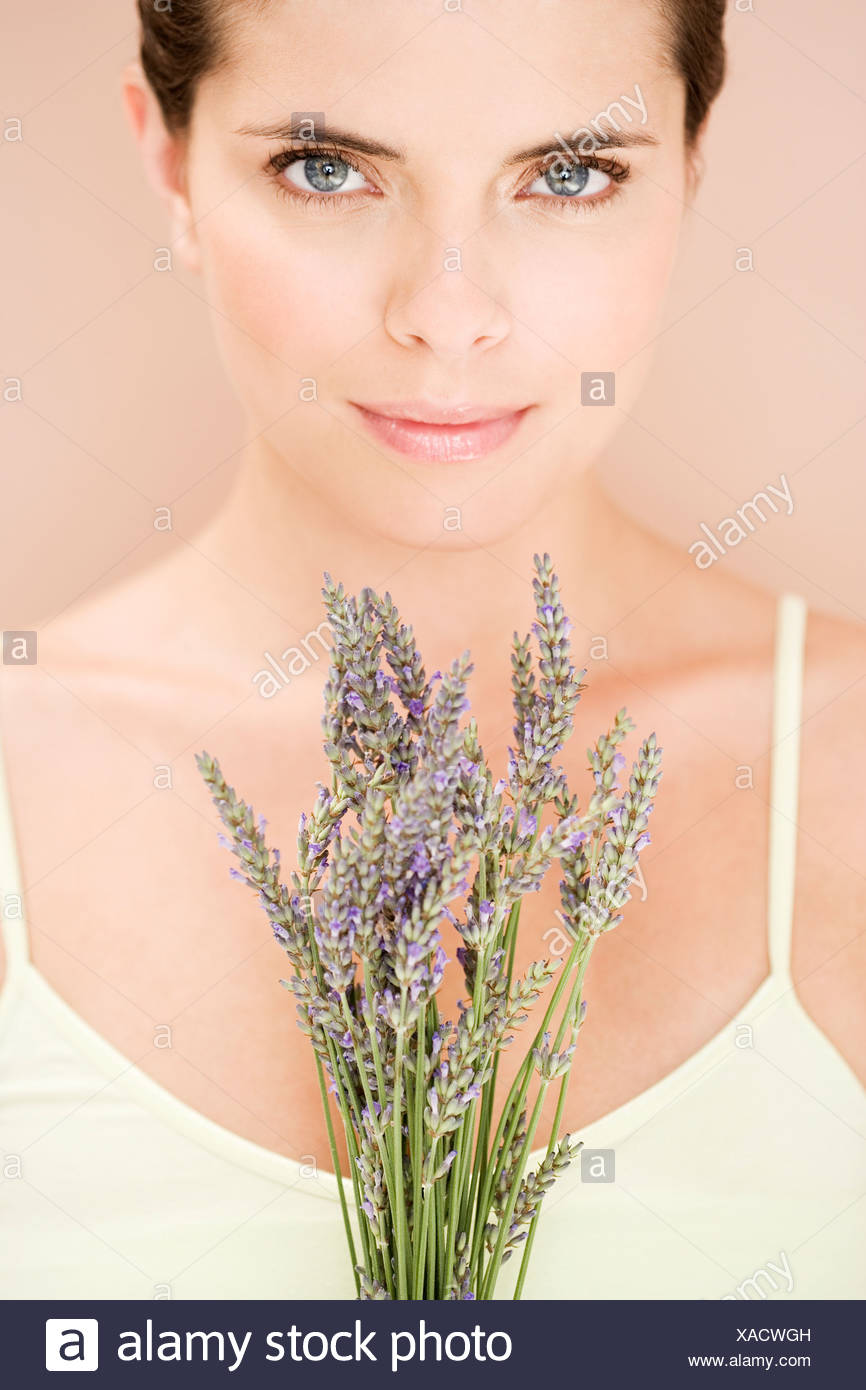 Woman holding a bunch of dried lavender - Stock Image