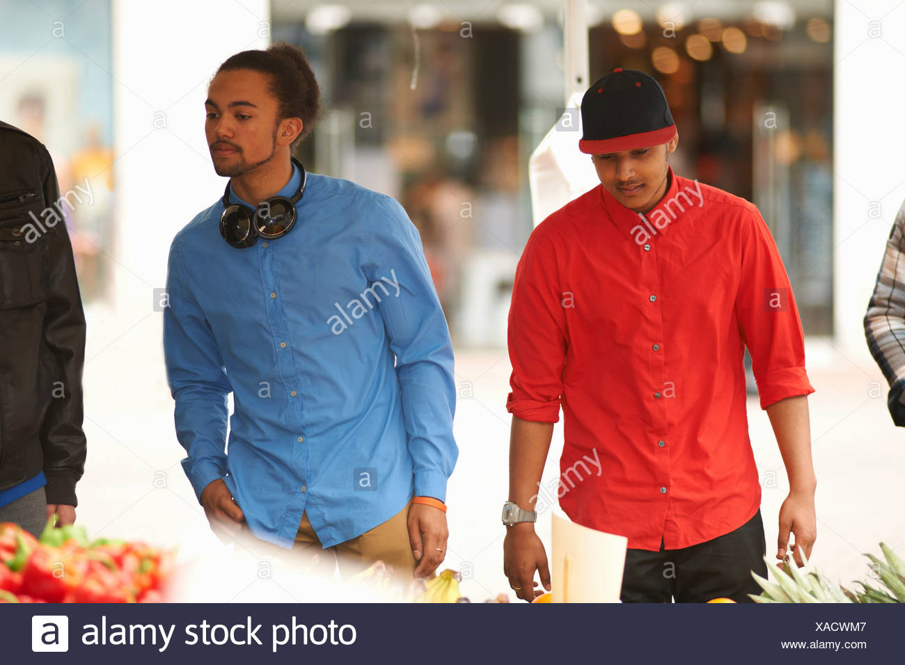 Two teenage boys at market - Stock Image