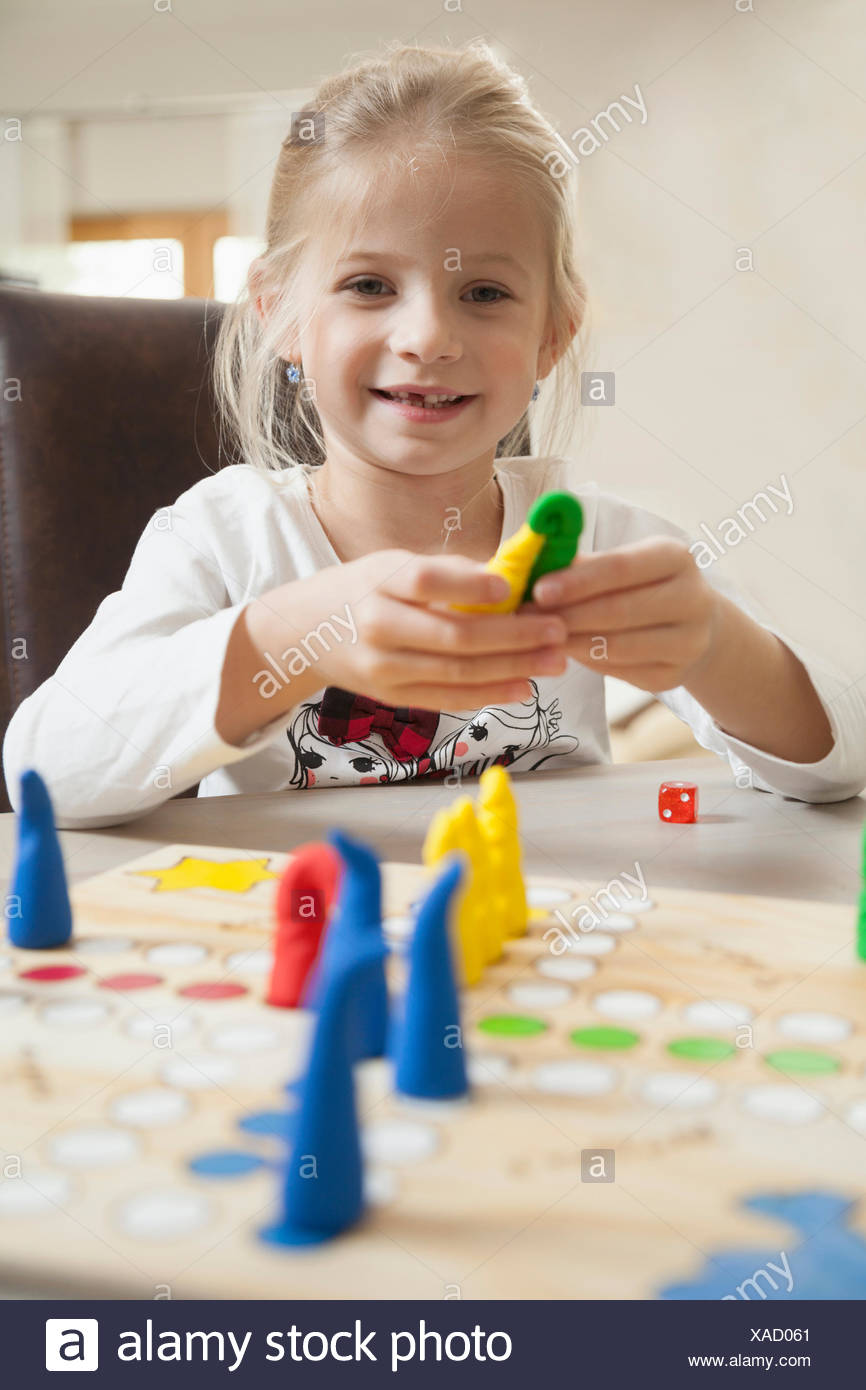 Girl playing board game, Bavaria, Germany Stock Photo