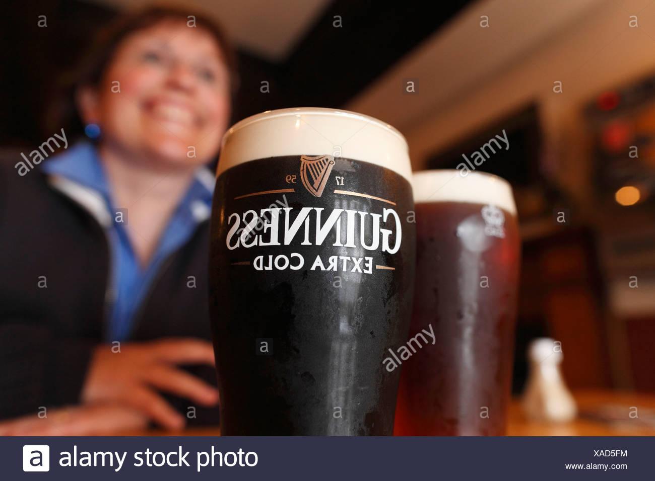Pint of Guinness, stout beer, Mary McBride's Pub, Cushendun, County Antrim, Northern Ireland, United Kingdom, Europe - Stock Image
