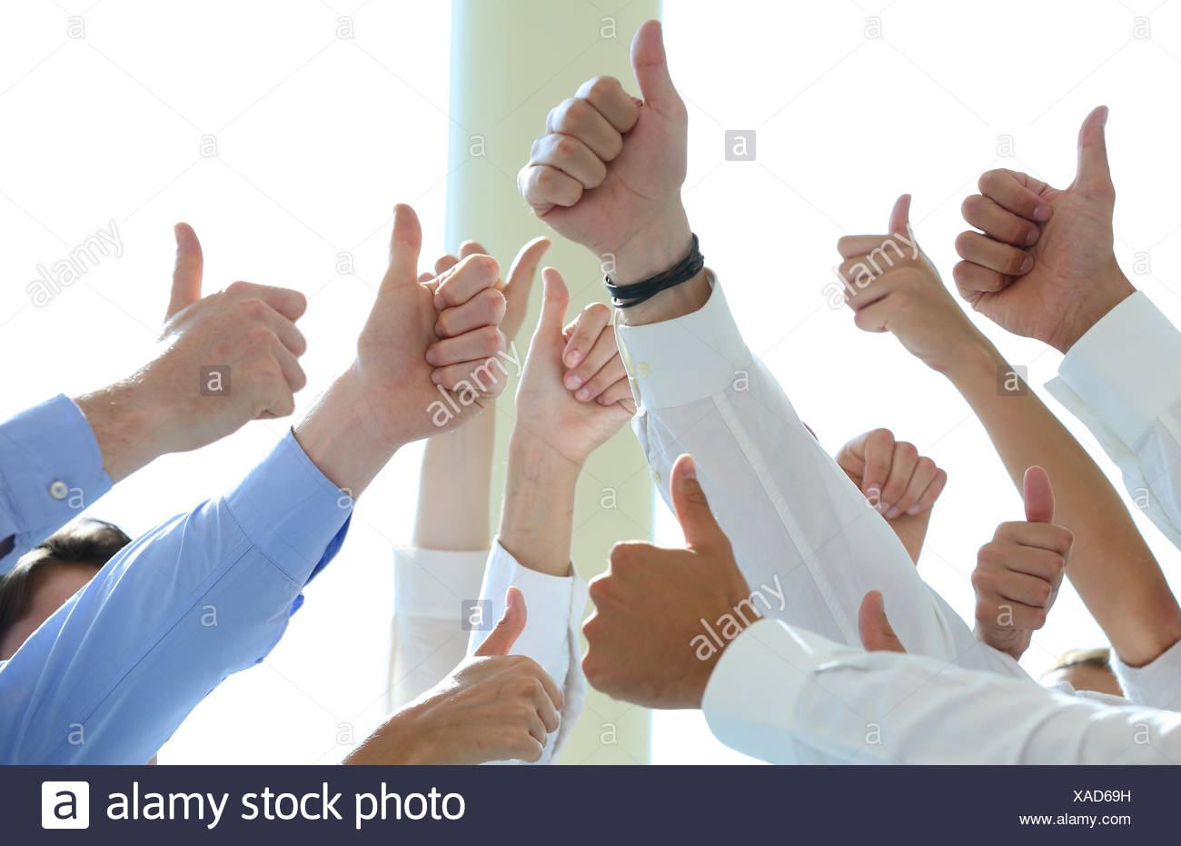 achievement adult approval arm Basque Country business businessman businesspeople businesswoman center close-up collaboration - Stock Image
