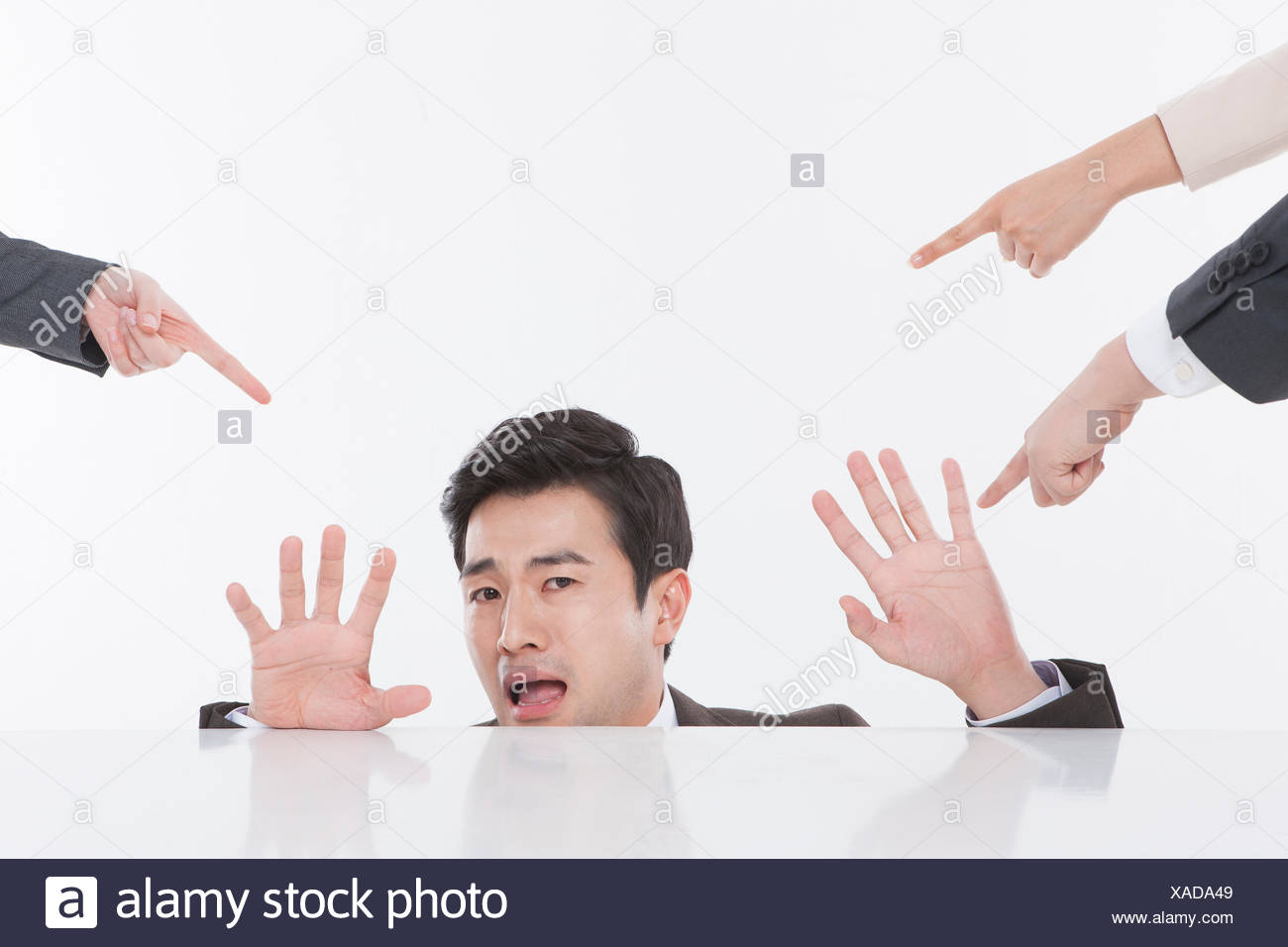 Portrait of stressful businessman and fingers pointing to him - Stock Image