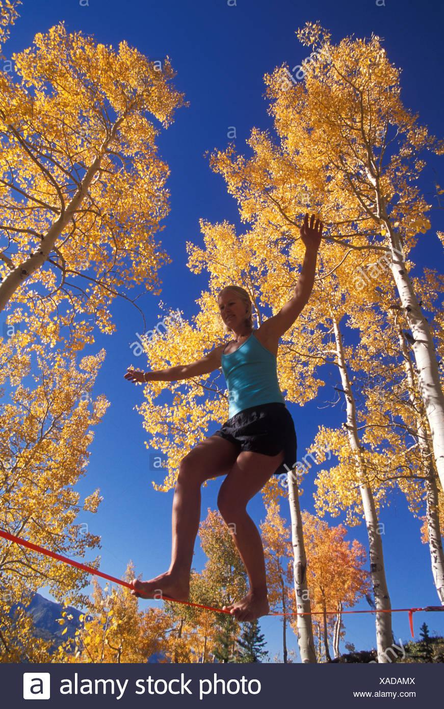 Slacklining, tight rope walker - Stock Image