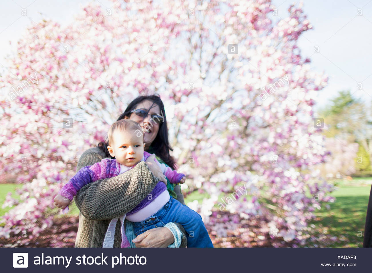 Grandmother and grandchild in garden - Stock Image