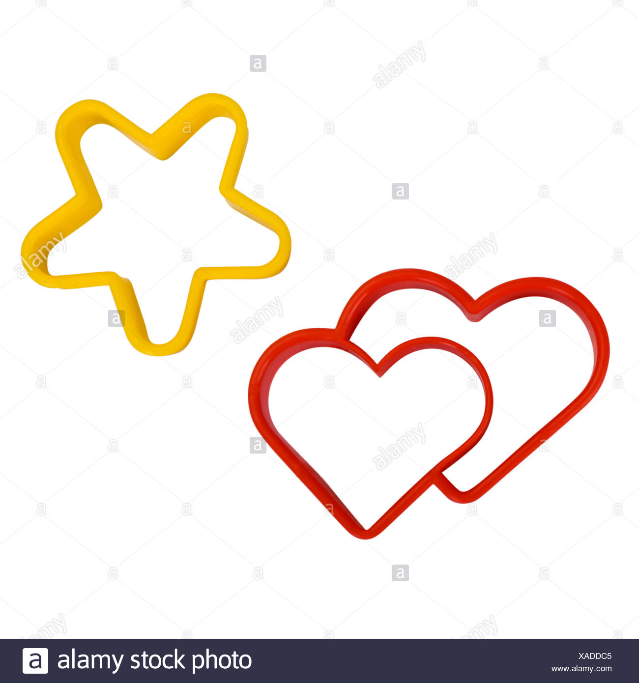 Close-up of a star and a heart shaped cookie cutters - Stock Image